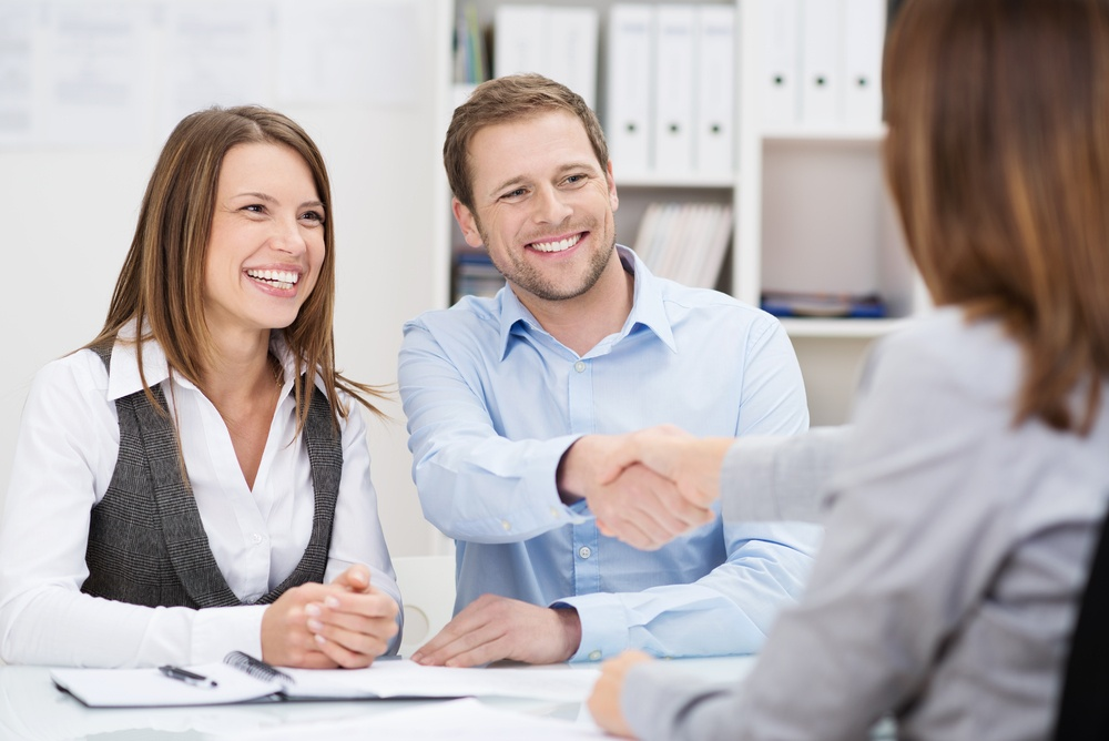 sales meeting where everyone looks happier than they should