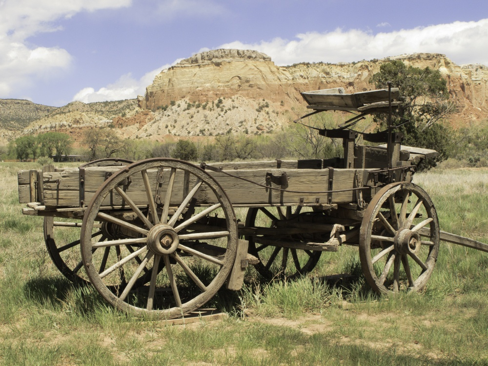 Basic transportation in the Old West wooden wagon on grassy valley floor in New Mexico.jpeg